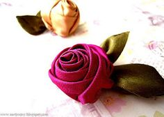 The 'Walnut' Rose Tutorial from meijosjoy.blogspot.com. Use ribbon or folded satin to make these beautiful wrapped roses. A nice pictorial tutorial.