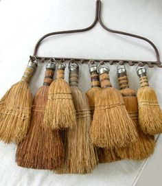 Collection of Vintage Brooms displayed on Rake Head ....