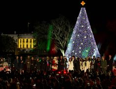 President Barack Obama and his family and along several musical performers at the National Christmas Tree Lighting Ceremony line the stage to sing holiday tunes in Washington, D.C. Among those who performed classic holiday hits were singers James Taylor, Kelly Clarkson and Marc Anthony.