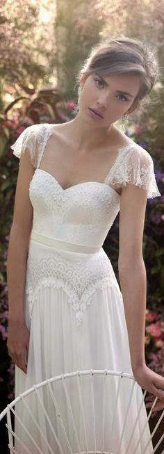 This bohemian style wedding gown looks great for an outdoor garden ceremony. The short flutter sleeves and the whimsical lace design is romantic. Have custom #weddingdresses like this one made in your price range by our US dress makers who specialize in affordable yet stylish #fashion options for the bride at http://www.dariuscordell.com