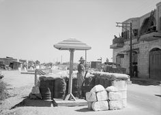 British soldier guarding the road between Rampla and Lydda Airport (now Ben Gurion Airport) in Palestine 21st April 1939., via Flickr.