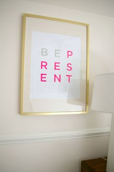 These IKEA RIBBA frames were spray painted gold. Genius idea to add glam on a budget. I'd spray paint them brown or bronze :]