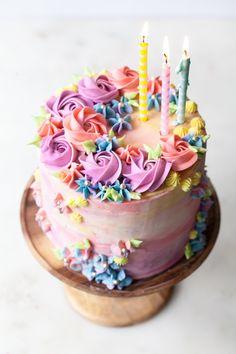 Sprinkle Birthday Cake with vanilla pastel buttercream swirls #confetticake #sprinkles #birthdaycake