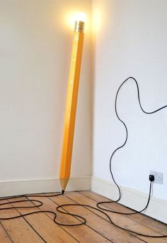 Quirky life size pencil lamp. If you want something unique in the room then this pencil lamp is perfect for you. The light is emitted from the pencil's eraser part.