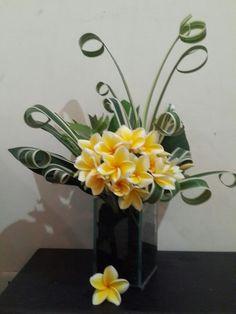 Tropical flower arrangement by ariana