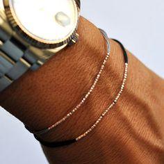 Rose gold beads on gray silk