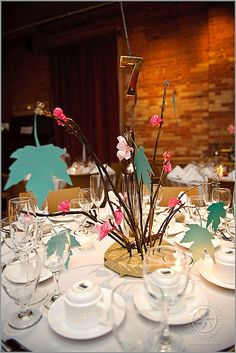 Cutout paper leaves on sticks for centerpiece