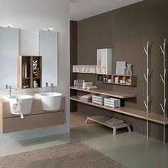 Couleurs sourdes et jolies vasques pour cette salle de bains