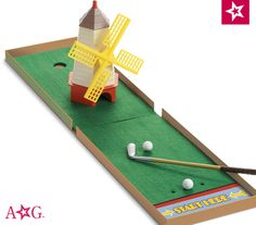 Kit's Mini Golf Set. Help Kit get a hole in one with this swell 1930s-style mini-golf set! It includes:  A working crank windmill to putt through • A real metal putter and 2 golf balls • Green felt pads to simulate grass •A decorative folding box for easy storage  $48