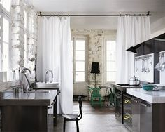 DAPPER DRAPES | There is something very refreshing about using an item in an unexpected way. For example, Drapery Panels don't have to be relegated to windows. To soften your space and create more intimacy, try using panels to flank interior doorways or as room dividers. #drapes #curtains #design #tip