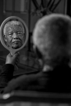 This image dated September 13, 2011, taken by photographer Adrian Steirn, shows former president Nelson Mandela's face reflected in a mirror. The portrait has been bought by a private art collector in New York, for $200,000, the highest price ever paid for a local portrait. The money will be donated to the Nelson Mandela Children's Hospital, currently under construction in Johannesburg, and to the World Wildlife Fund. The portrait is a series of 21 portraits of South African icons.