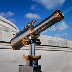 Look at planets and stars with a telescope
