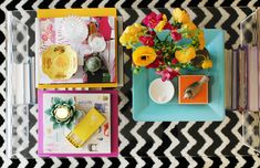 Coffee table styling via The Everygirl. Love the colors and the trays