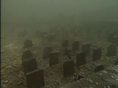 An underwater graveyard in Llyn Celyn, Wales. The village it was located in was flooded in the 60's to supply water to Liverpool.