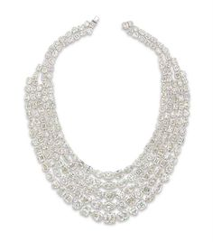 A DIAMOND NECKLACE The front designed as five swags of graduated vari-cut diamonds, extending to the two row backchain, mounted in platinum, 42.5 cm
