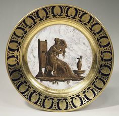 Plate c, 1808    Sèvres Manufactory (French, 1740–present); Decorated by Pierre André Le Guay (French, active 1773–1817); gilded by Joseph-Léopold Weydinger (French, active 1778–1804, 1807–8, 1811, 1816–29) Hard-paste porcelain