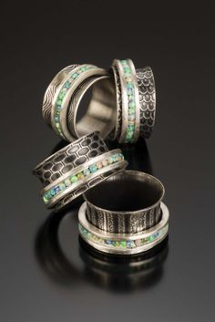 Spinner Rings with lab opal by Dana Evans Studio.