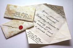 *Handmade parchment invitations with calligraphy and wax seal