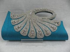 Peacock shaped clutch.