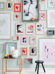 love this full wall photo display with varied sizes of frames.