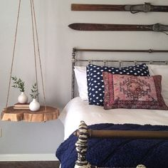 A wood stump hung in the bedroom makes the perfect bedside table! See it on HGTV's Fixer Upper.