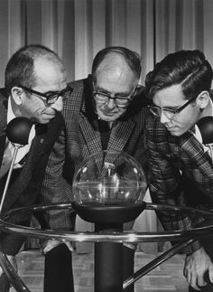 Raymond Stoenner, Raymond Davis and Warren Lyman look at a moon rock brought back by the Apollo 11 crew. / Brookhaven National Laboratory
