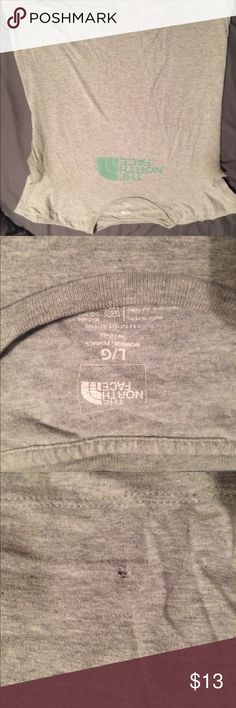 The north face womens tee Gently worn, small hold in front near hem The North Face Tops Tees - Short Sleeve
