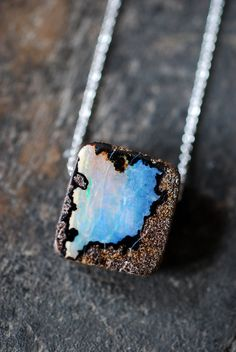 Raw Boulder Opal Pendant. I don't tend to like jewelry. However, this is my birthstone, and kinda pretty!
