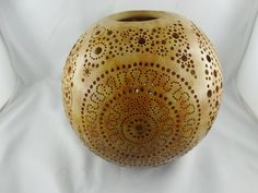 Photophore gourd. Diameter 18 cm. Dyeing and wood wax.