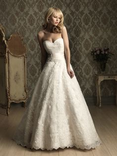 Allure 8850 A lovely, A-line ball gown constructed from an all-over lace applique. The strapless bodice features a sweetheart neckline and ruched waistband accented with a beaded and crystal applique. The ball gown has a zipper back and chapel length train.
