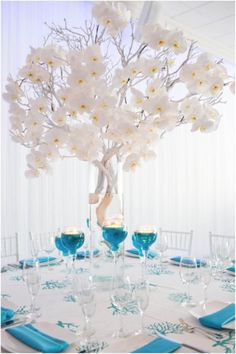 Beautiful Orchid tree centerpiece made with silver branches!