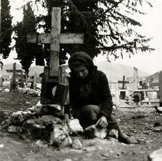 Image A survivor of the Distomo massacre (1944) tending a grave in 1945. Photograph by Voula Papaioannou