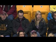 This guy and his sister ended up on the kiss cam at a recent Minnesota Gophers hockey game . | This Guy Figured Out Exactly What To Do If You And Your Sister End Up On A Kiss Cam Together