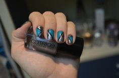 Mirrored geometric nails.