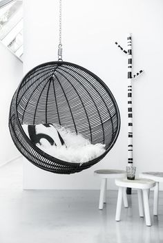 Hanging Rattan Bowl Chair in Black via Kate Young Design Bubble Chair, Deco Retro, Black And White Interior, Black White, White Fur, Interior Decorating, Interior Design, Swinging Chair, Deco Design