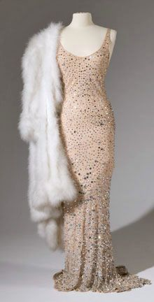 """The famous dress that Marilyn Monroe wore to seductively serenade President Kennedy with """"Happy Birthday"""" in 1962. Jean Louis designed the dress as he designed his 'nude illusion' costumes for Marlene Dietrich, aiming for the effect of her wearing only sequins and beads on bare skin. He achieved this partly by dying the fabrics to match each star's skin tone."""