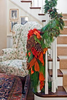 Festive Holiday Staircases and Entryways - Traditional Home® christma stair, ribbon, christmas stairs, christma decor, christma idea, christmas decorating ideas, garland, holiday decor, traditional homes