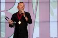 Songwriter and Song of the Year honoree Chris Tomlin accepts his award at the 2014 BMI Christian Awards.