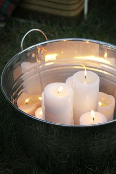 Halloween Party Ideas: candles in a shiny galvanized tub. Shannon Claire of Burlap and Lace used this instead of a bonfire in her backyard for a ghost-story part. But this would be terrific, too, for an indoor Halloween party. See Shannon's fun outdoor party set up on The Home Depot Blog. || @burlapandlace
