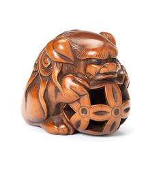A boxwood netsuke of a shishi By Masanao, Ise, 19th century