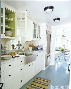 Painting the interior of kitchen cabinets a contrasting color — in this case apple green — is something both architect Gil Schafer and his color consultant, Eve Ashcraft, love to do. Aside from supplying a shot of color, it sets off the china.