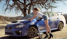 Ahhh the classic scene of a hot chick cleaning a cool car. Check out the new sexy Subaru commercial here...