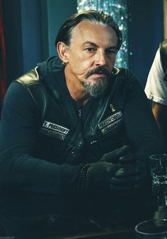 I don't know if it's his sexy accent, the way he looks in his leather, the way he looks in a hoodie and his holster, but gee whiz Tommy Flanagan is HOT!!