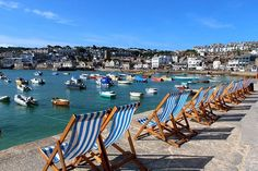 """This photograph of deckchairs overlooking St Ives Harbour, Cornwall was taken by Julie Taylor on Monday. She said: """"It was lovely and peaceful just before the crowds arrived and the scene looked its best on what was a stunning morning."""" To mark the start of the Olympic Games in Rio, this week's theme for #EnglandsBigPicture will be the Olympic story. Send your Olympic-inspired pictures to england@bbc.co.uk #england #stives #cornwall #deckchairs #summer #weather #rio2016"""