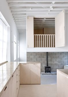 Wooden hatches fold open to reveal a new loft room inside this former Victorian schoolhouse