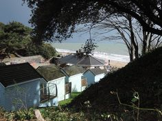 A view of the beautiful colours of buildings, trees and water at my local beach at Alum Chine, Bournemouth.