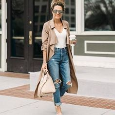 @hellofashionblog  wears a pair of ripped denim jeans, rolled at the ankle, paired with a white V neck tee and a blush pink coat and sneakers. These neutral, calming tones are perfect for spring mornings.  Brands not specified.  https://www.justthedesign.com/outfits/spring/what-to-wear-for-spring/  #fashion, #fashionista, #fashionblogger, #streetstyle, #fashionicon, #instastyle, #instafashion