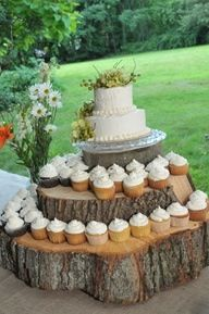 Simple yet elegant set up for wedding cake and cupcakes. Rustic