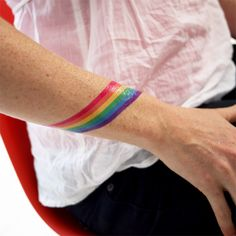 The possibilities of a rainbow tattoo design are endless as it is one of the most colorful and joyful tattoo designs in tattoo art. Plus it's symbolic and meaningful aspect that attracts most of us… Gay Pride Tattoos, Equality Tattoos, Gay Tattoo, Temp Tattoo, Arm Band Tattoo, Girl Tattoos, Tattoos For Guys, Temporary Tattoo, Wrist Tattoo
