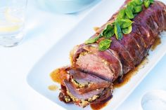 Add festive colour to your Christmas table with basil-topped, pesto-filled beef.